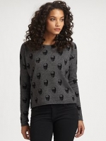 Dorrit's grey sweater at Saks Fifth Avenue