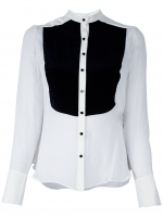 Robin's black and white blouse at Farfetch
