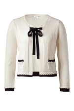 White cardigan with black tie at Stylebop