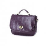 Purple handbag with gold closure at Yes Style