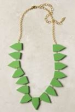 Aria's green necklace at Anthropologie