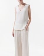 Hanna's studded top at Zara