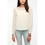 Similar blouse with lace inset at Urban Outfitters