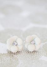 White flower earrings at Ruche
