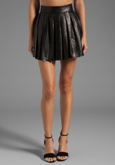 ALICE and OLIVIA Box Pleat Leather Skirt in Black at Revolve