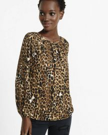 Banded bottom leopard print blouse at Express