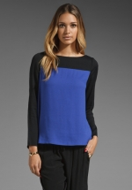 Blue and black colorblock sweater at Revolve