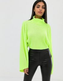 82be9202dc2 WornOnTV  Eve s green cropped turtleneck sweater on The Talk