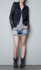Boucle jacket with leather sleeves at Zara