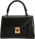 Carries black bag at Barneys at Barneys