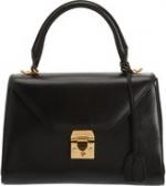 Carries black bag at Barneys at Barneys