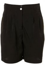 Carries black shorts from Topshop at Topshop