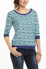 Carries striped and polka dot shirt at Anthropologie