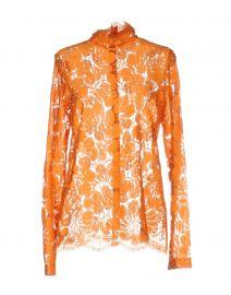 Celine orange blouse at Yoox
