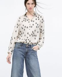 Contrasting printed blouse at Zara