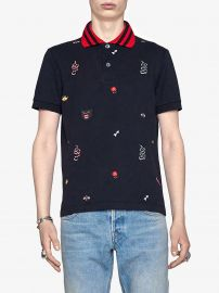 Cotton polo with embroideries by Gucci at Farfetch