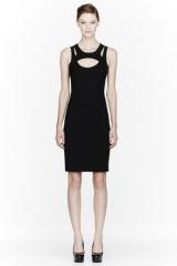 Cutout harness dress by Versace at SSENSE