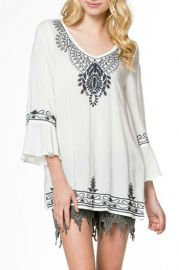 Embroidered knit top at Shoptiques