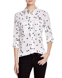 1aef2e7a9df085 WornOnTV: Sofia's white star print shirt on Young and Hungry | Aimee ...