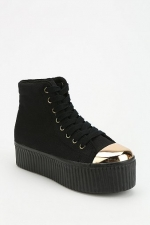 Gold capped flatform sneakers by Jeffrey Campbell at Urban Outfitters