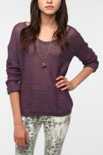 Haley's purple knit sweater on Modern Family at Urban Outfitters