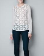 Hanna's white blouse at Zara