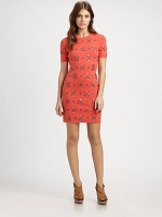 Mindy's coral dress at Saks Fifth Avenue