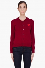 Mindy's red heart cardigan at Ssense