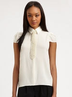 Mindy's white pearl tie top at Saks Fifth Avenue