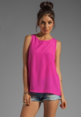 NAVEN Long Muscle Tank in Pop Pink at Revolve