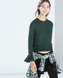 Pleated top in bottle green at Zara