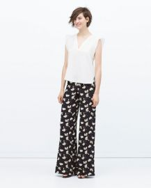 Printed bell bottom trousers at Zara