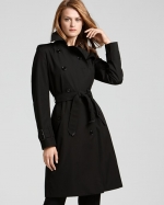 Reginas black trench coat at Bloomingdales