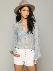 Sheer polka dot blouse at Free People