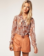 Similar floral blouse with bow at Asos