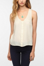 Similar white sleeveless top at Urban Outfitters