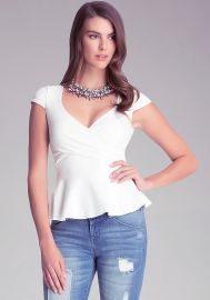 Solid Peplum Top in white at Bebe