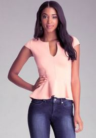 Split neck peplum top at Bebe