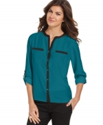 Teal shirt with black contrast trim at Macys