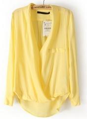 Yellow cross dipped hem blouse at She Inside