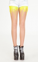 Yellow melting tights on the Still into You video at Urb