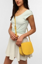Yellow saddle flap bag at Urban Outfitters at Urban Outfitters