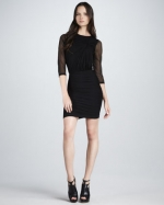 Zoe's sheer black dress at Neiman Marcus