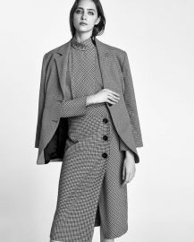 checked wrap-style midi skirt at Zara
