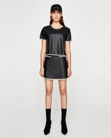 contrasting faux leather mini skirt at Zara