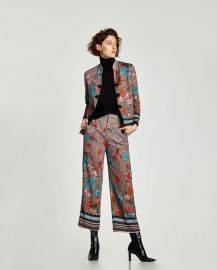 flowing jacket with grommets at Zara