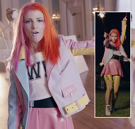 Hayleys pink leather skirt and white boots with dweeb shirt on Still into you Paramore video